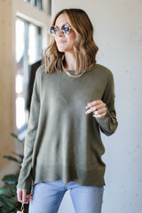 Olive - Model wearing a Loose Fit Sweater with a gold layered necklace