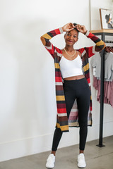 Dress Up model wearing a Striped Duster Cardigan with leggings