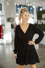 Model wearing a Ribbed Knit Tiered Surplice Dress