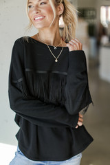 Dress Up model wearing a Fringe Pullover with jeans