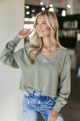 Olive - Dress Up model wearing a Cropped Pullover with jeans