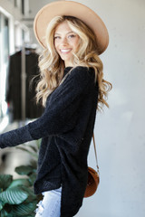 Oversized Fuzzy Knit Top in Black Side View