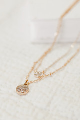 Flat Lay of a Gold Rhinestone Layered Necklace
