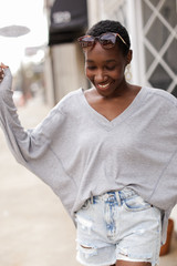 Model wearing an Oversized Waffle Knit Top with denim shorts Front View
