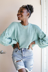Sage - Model wearing a Statement Sleeve Cropped Sweater