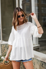Ivory - Dress Up model wearing a Puff Sleeve Babydoll Top with sunglasses