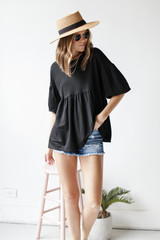 Puff Sleeve Babydoll Top in Black Front View on model