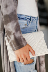 Ivory - Model carrying a Quilted Crossbody Bag