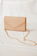 Nude - Close Up of a Quilted Crossbody Bag