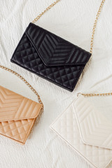 Flat Lay of 3 Quilted Crossbody Bags