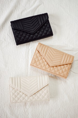 Flat Lay of all 3 colors of the Quilted Crossbody Bag