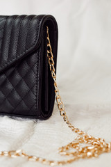 Close Up of a Quilted Crossbody Bag in Black