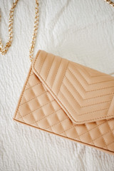 Close Up of a Quilted Crossbody Bag in Nude