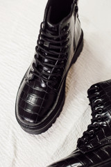 Close Up of black Platform Crocodile Combat Boots