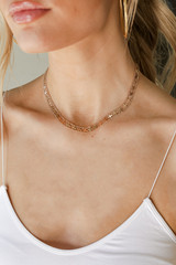 Model wearing a Gold Cross Necklace