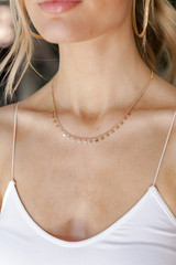 Model wearing Gold Star Necklace