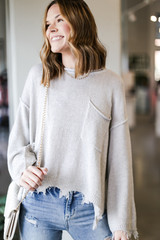 Model wearing an Oversized Distressed Sweater