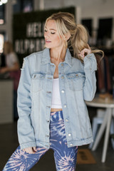 Light Wash - Model wearing a Distressed Denim Jacket