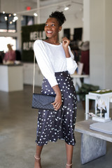 Dress Up model wearing a Spotted Midi Skirt