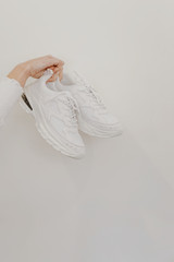 Chunky Sneakers on a white wall