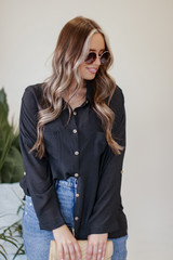 Dress Up model wearing an Oversized Button-Up Blouse in Black