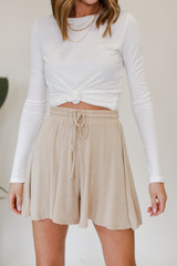 Taupe - Model wearing Lounge Shorts with a white tee