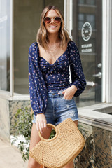 Navy - Model wearing a Floral Balloon Sleeve Top