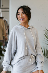Heather Grey - Model wearing an Oversized Brushed Knit Hoodie