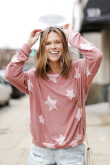 Mauve - Dress Up model wearing an Oversized Star Pullover