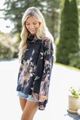Model wearing an Oversized Floral Knit Top