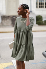 Olive - Model wearing a Tiered Babydoll Dress