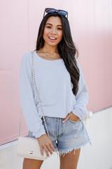 Light Blue - Model wearing a Pullover with denim shorts
