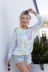 Model wearing a Tie-Dye Cutout Pullover with denim shorts