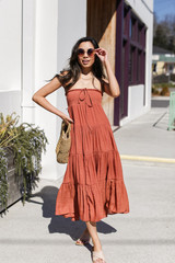 Rust - Model wearing a Boho Maxi Skirt with straw bag