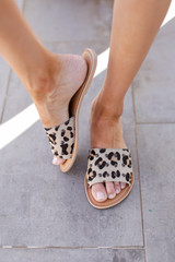 Model wearing Leopard Slide Sandals by MATISSE FOOTWEAR