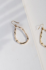 Flat Lay of Hammered Gold Drop Earrings
