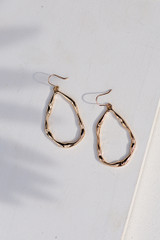 Close Up of Hammered Gold Drop Earrings