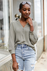 Olive - Model wearing a Linen Top