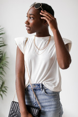 White - Model wearing a Shoulder Pad Muscle Tee
