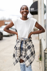Model wearing a white Shoulder Pad Muscle Tee with a flannel