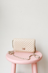 Ivory - Flat Lay of a Quilted Crossbody Bag