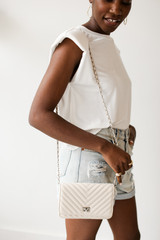 Ivory - Model wearing a Quilted Crossbody Bag