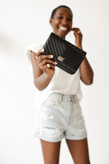 Model holding a Quilted Crossbody Bag in Black