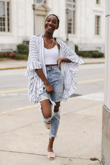 Ivory - Model wearing a Ruffle Button Up with distressed jeans