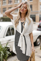 Model wearing a Button Up Top in White over a bodycon dress