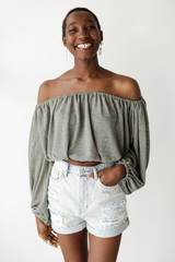 Model wearing a Balloon Sleeve Top with denim shorts