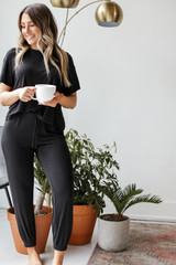 Dress Up model wearing black Feel Good Joggers with the matching tee