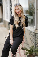 Model wearing a black Short Sleeve Tee