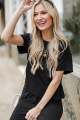 Model wearing a black Short Sleeve Tee with the matching joggers