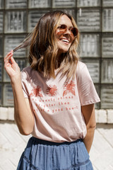 Model wearing the Good Heart Floral Graphic Tee